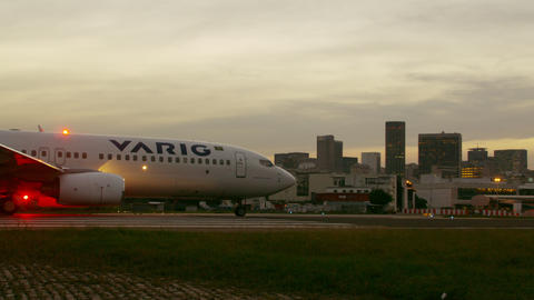 Panning shot of airplane taking off in Rio de Janeiro, Brazil Footage