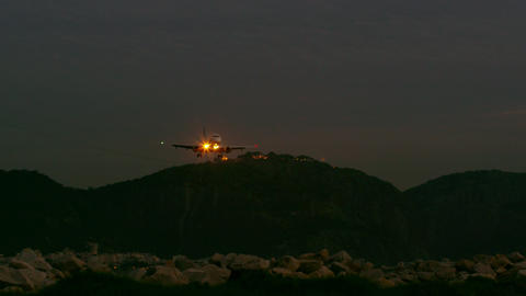 Panning shot of hills of Rio de Janeiro and landing plane Footage