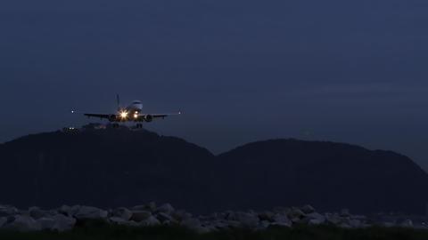 Plane lands at Jacarepaguá airport in early morning Footage
