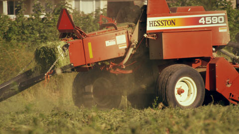 Medium shot of a square hay baler Footage