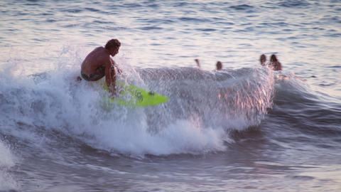 Shot of a young male surfer surfing along the coast in Costa Rica Footage