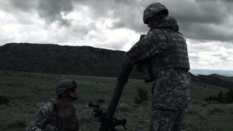 Slow motion shot of soldiers firing mortar launcher at range Footage