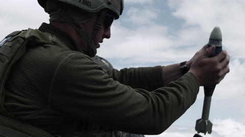 Close up shot of soldiers firing mortar system Footage