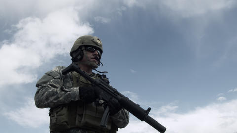 Soldier with weapon down, aiming, firing, lowering weapon Footage
