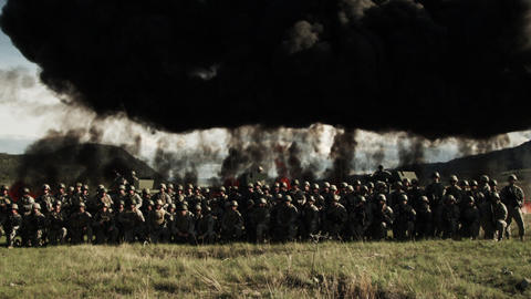 Fire explosion line behind soldiers Footage