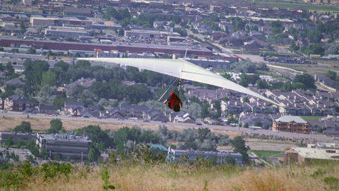 Hang glider is taking off from hill overlooking South Salt Lake valley in Utah Footage