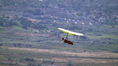 Person is Hang gliding near the Jordan, South Salt Lake Valley Footage