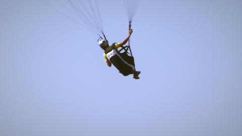 Paragliding man turning to the left in the air near Point of the mountain in Uta Footage