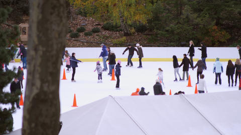 Sow panning shot of ice rink in central park Footage