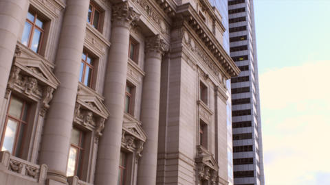 Tracking shot of intricate building with columns Live Action