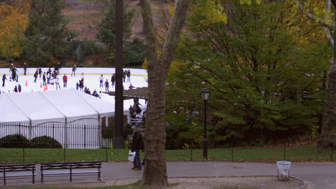 tracking shot of people walking by icerink Footage