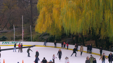 Tilt shot of skating rink in central park Footage