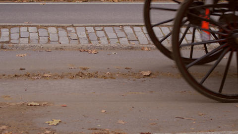 Dolly shot of two horse drawn carriages passing Footage