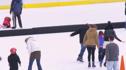Slow motion shot of ice skaters on the Central Park ice rink in New York City Footage