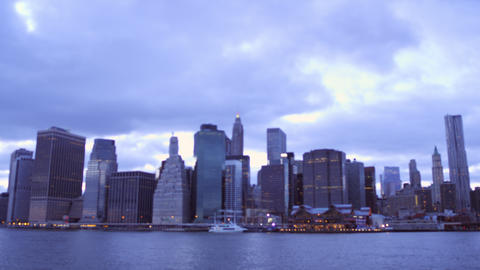 Panning shot of New York City from a distance over the water Footage