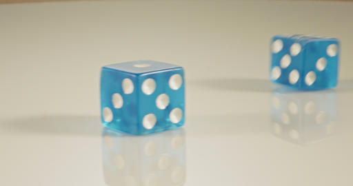 Slow motion macro shot of dice falling and rolling on… Stock Video Footage