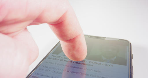 Macro shot of finger scrolling through social network on a smartphone Live Action