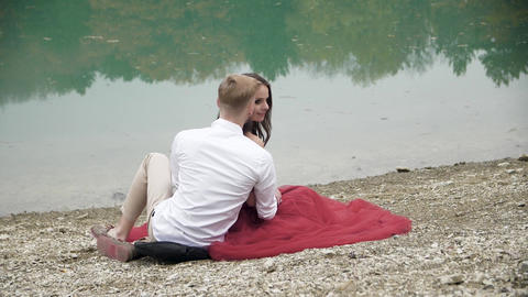 date on the shores of the turquoise lake in a romantic style Footage