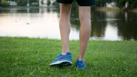 Athletic young man strething, preparing for marathon long distane run outdoors Footage