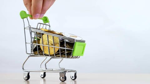 Hand controls shopping cart or market basket isoleted on white background Live Action