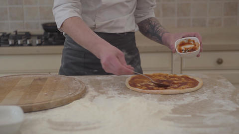 Pizza maker cooking pizza on traditional italian recipe. Chef making italian Live Action