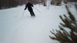 Skier enjoys idyllic perfect weather on winter day for recreation skiing down Footage