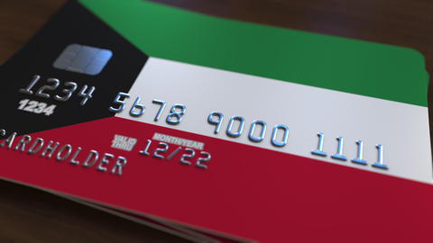 Plastic bank card featuring flag of Kuwait. Kuwaiti national banking system Footage