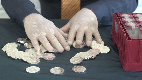 man with a bunch of silver coins Archivo