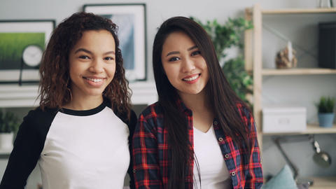 Slow motion portrait of pretty students mixed-race friends Asian and African Live Action