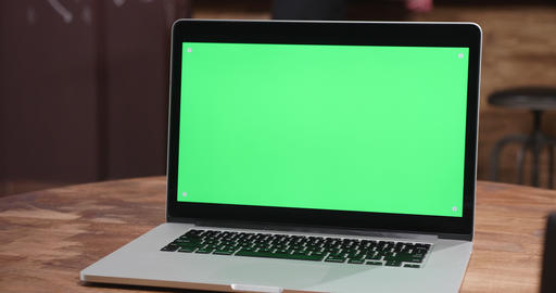 Parallax shot of modern laptop with green screen Footage