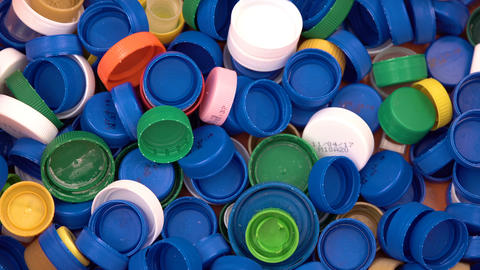 Colorful plastic bottle caps. Studio shot. Plastic waste Footage