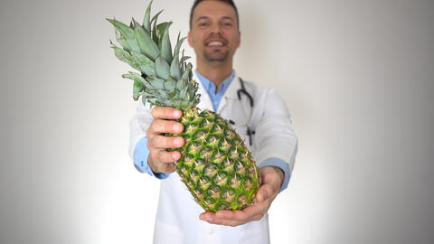 Doctor Holding Natural Organic Pineapple, Healthy Vitamin Nutrition Concept Live Action