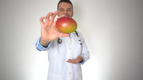 Doctor Holding Natural Organic Mango, Healthy Vitamin Nutrition Concept Footage