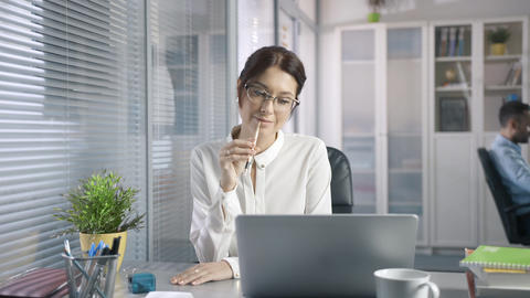 smiling employee reads email from a client an sales report on the market service Footage