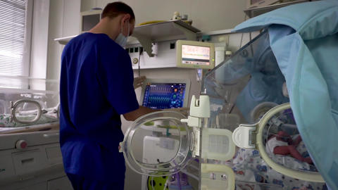 The doctor looks at the screen. Childrens Resuscitation Footage
