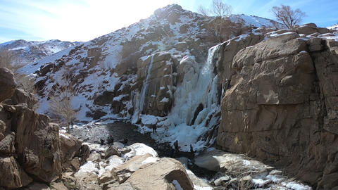 Walking near the waterfall Footage