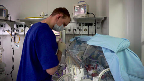 A doctor in the intensive care unit. Resuscitator equipment. Neonatal incubator Footage