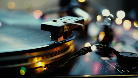 Festive mood, bokeh lights shining over Vintage Vinyl Turntable Record Player Footage