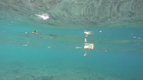 Garbage floating underwater, ecology catastrophe, pollution, disaster Live Action