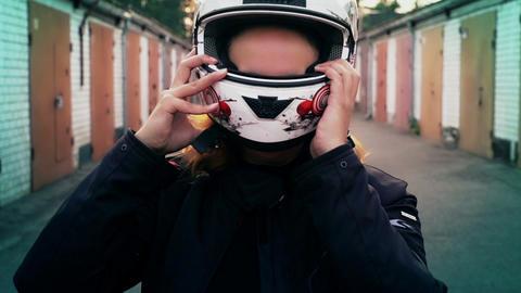 Redhead woman rider putting on motorcycle helmet. Biker... Stock Video Footage