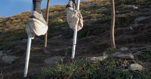 Iron stilts walk on the ground in mountain with sunlights Footage