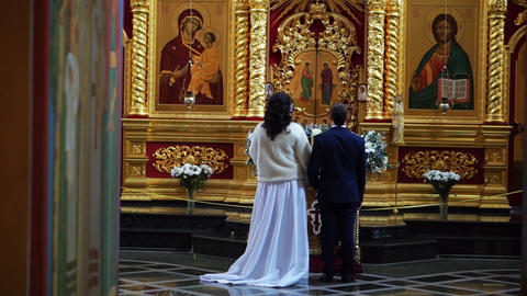 Just married in the temple. Groom and bride on their wedding day in church Footage