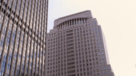 Dolly shot of two big buildings in New York City Footage