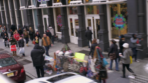 Dolly shot of people walking down the sidewalk in New York City Footage