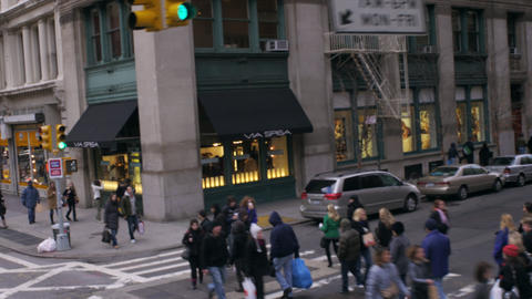Dolly shot of people crossing an intersection in New York City Footage
