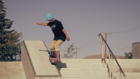 Shot of a skater doing a grind down a ledge with stairs Footage