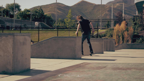 Shot of some skateboarders doing various tricks at a skatepark Footage