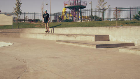 Slow motion shot of skateboarder falling after trying to kickflip a gap at a ska Footage