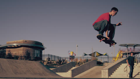 Shot of a skateboarder doing a frontside 360 out of a ramp at a skatepark Footage