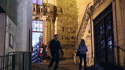 people walking by old street from Coimbra at night, Portugal slider Shot Footage